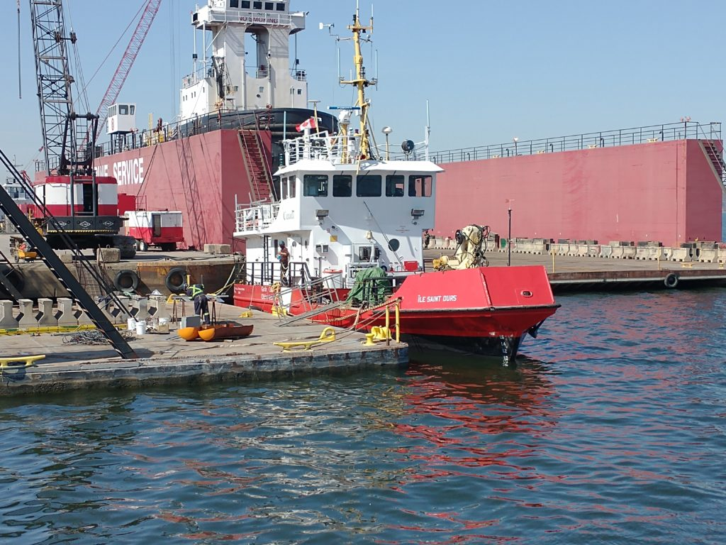 A Canadian Coast Guard vessel is tied to a dock
