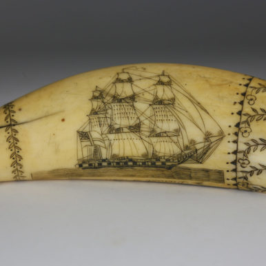 Scrimshaw whale tooth with image of a ship, from the nineteenth century